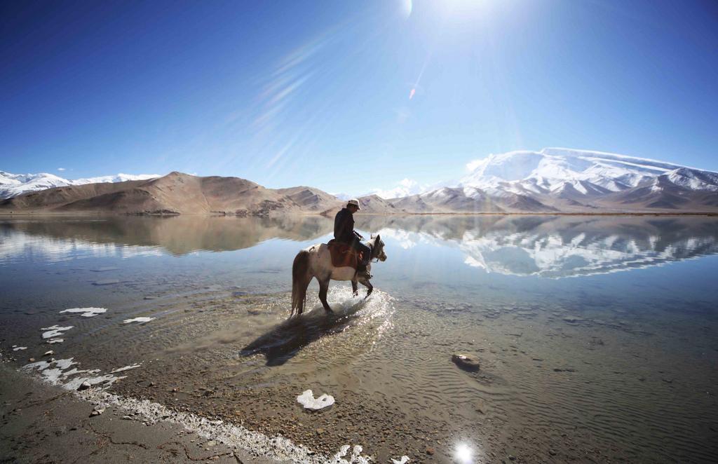 Wading into Lake Karakul Xinjiang