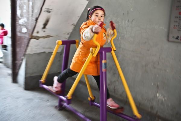 Girl on playground Orange jacket