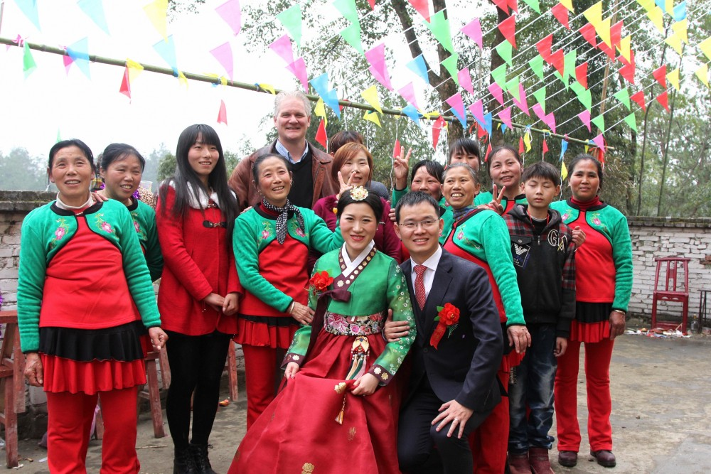 Frank: After the wedding, I pose with Xiao Piao, Rocky and his dancing aunties in the courtyard of his family home in a remote village in Hubei province.